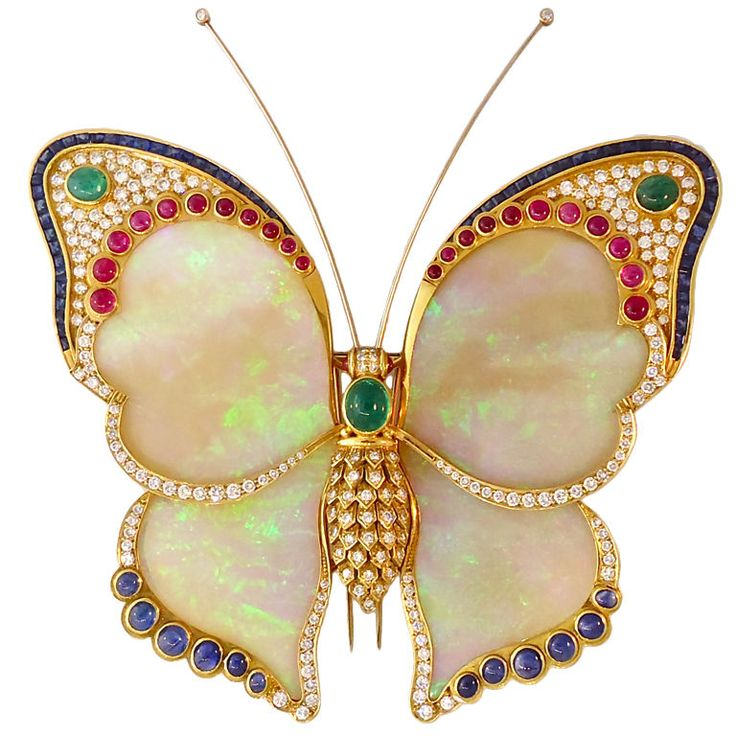 Breathtaking Opal Butterfly Pendant  U.S.A.  Late 20th Century  A pendant / pin…