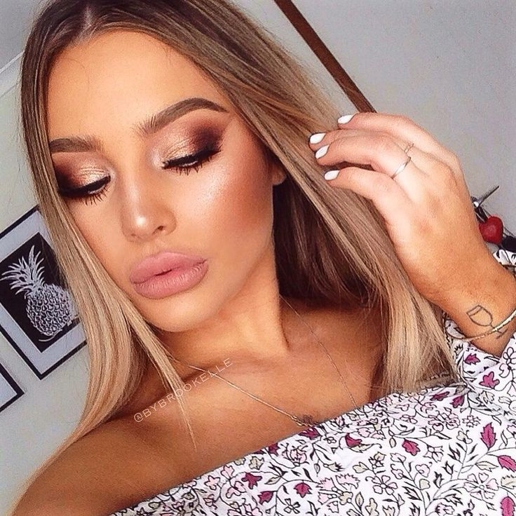 Copper smokey eye. Eyeshadow, blonde hair, off the shoulder top. You can get this look with the naked palette