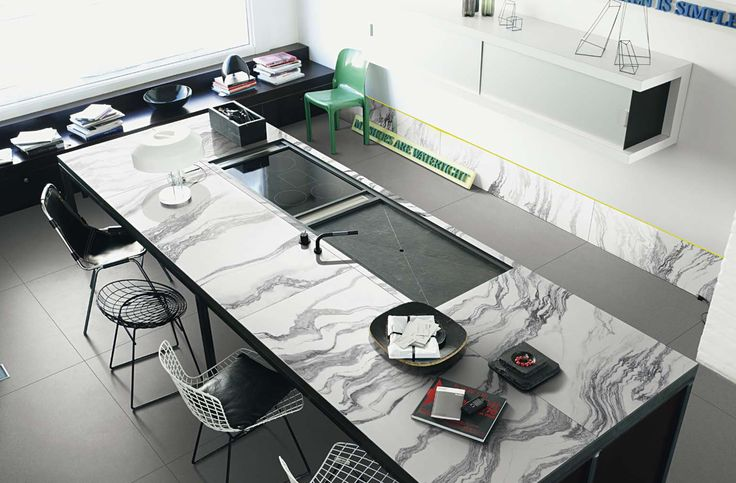 Sleek and modern kitchen design with marble like tiles for countertop from 41zero42's Open collection.