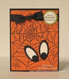 Spider web embossing with ribbon and eyes Halloween card