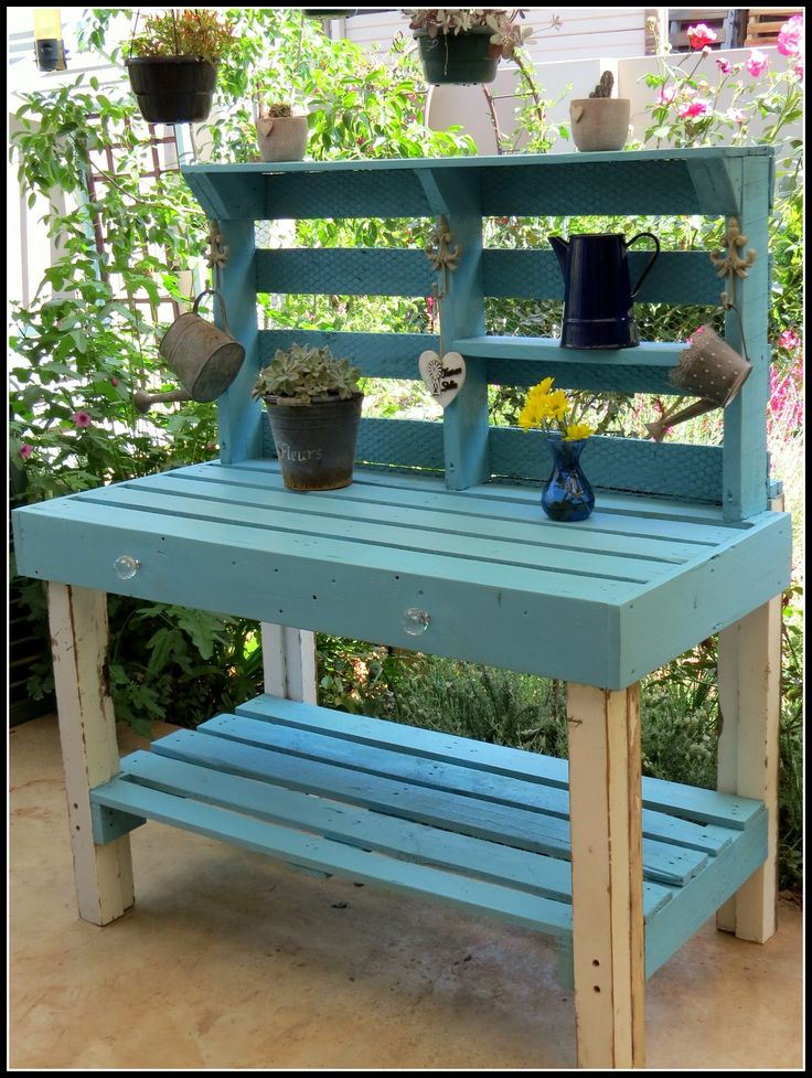 Duck egg blue potting table with white highlights. made from pallets & reclaimed wood.Perfect for outdoor furniture or in your kitchen.Order it now from www.not2shabby.co.za