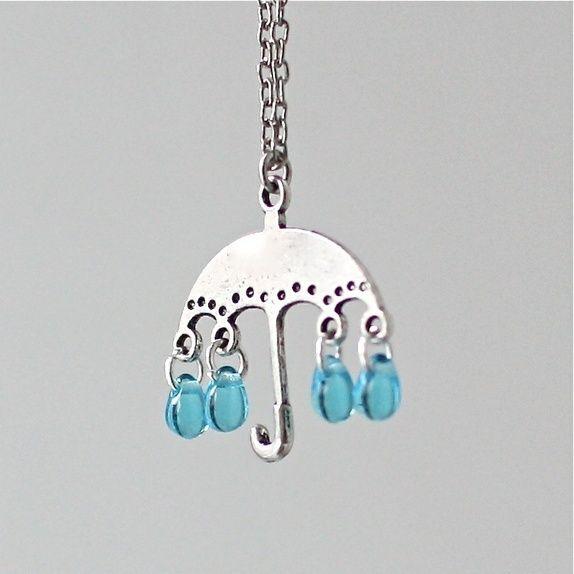 Paraply i regnvær- halssmykke med blå glassperler