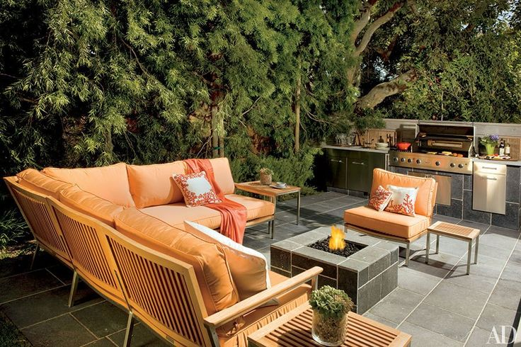 At Giada De Laurentiis's family home in Southern California, landscape designer Sean Knibb planted a wall of podocarpus trees for privacy around the outdoor kitchen and fire pit