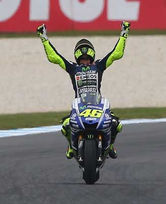 Totalposter.com - Valentino Rossi of Italy rider of the #46 Movistar Yamaha MotoGp Yamaha celebrates after winning the 2014 MotoGP of Australia at Phillip Island Grand Prix Circuit in Phillip Island, Australia
