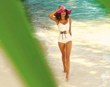 Bold accessories give island flair to this bathing suit! Wouldn't this be perfect on a vacation in #SouthCaicos?