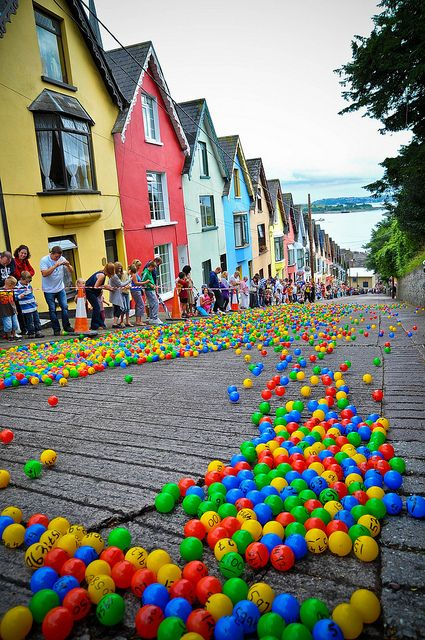 The Barrack Hill Ball Roll is a unique lottery when thousands of coloured numbered balls cascade and bounce down West View in Cobh, Ireland >> Has anyone seen this?