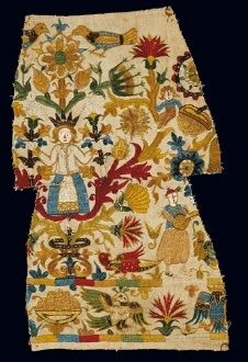 Cretan embroidery Part of embroidery depicting a woman on a floral ground and a musician in breeches playing his lute. From Crete, 17th c. 0.37x0.20 m. Gift of Manina Mantzouni in memory of Anna Apostolaki.