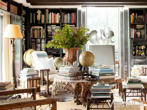 Cerused oak bookshelves are filled with 4,000-plus volumes of books from around the world. DESIGN BY JUAN MONTOYA Tour the entire home.   - Veranda.com