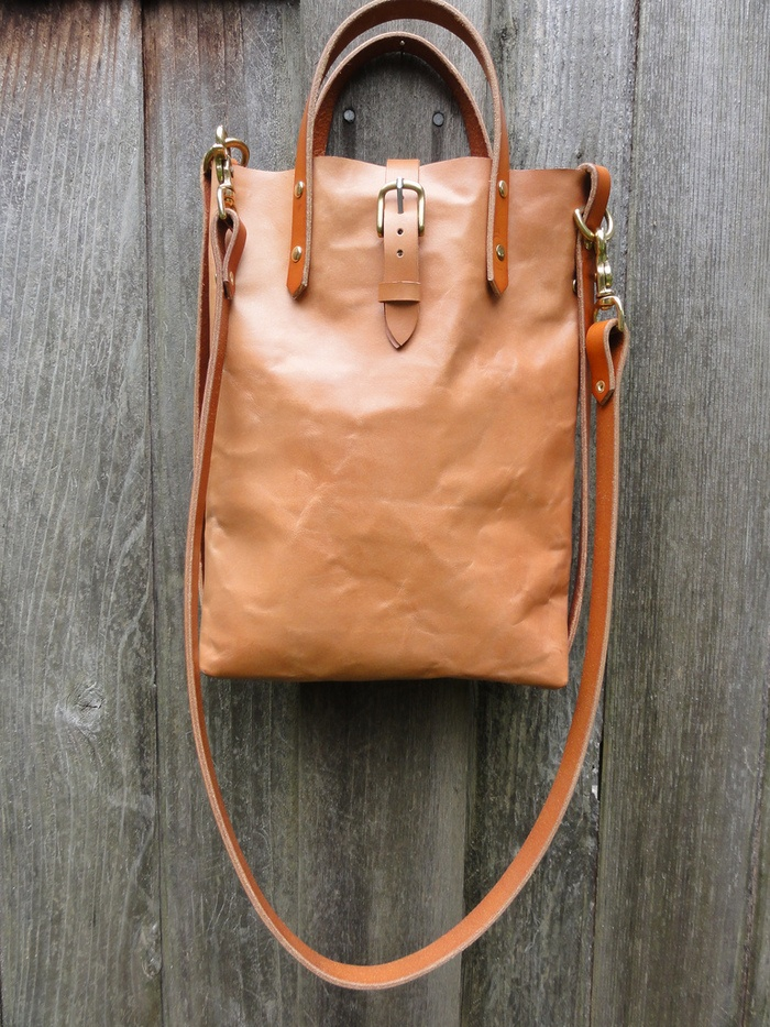 From Kickstarter- Hunter Pass Leather Goods is the collaborative effort of Portland, Oregon-based sisters Carlee and Aubree Ng, who found themselves experimenting with belt-making and bag-making after they inherited a set of antique leather-making tools from their uncle. Their hobby quickly grew into a thriving, small company