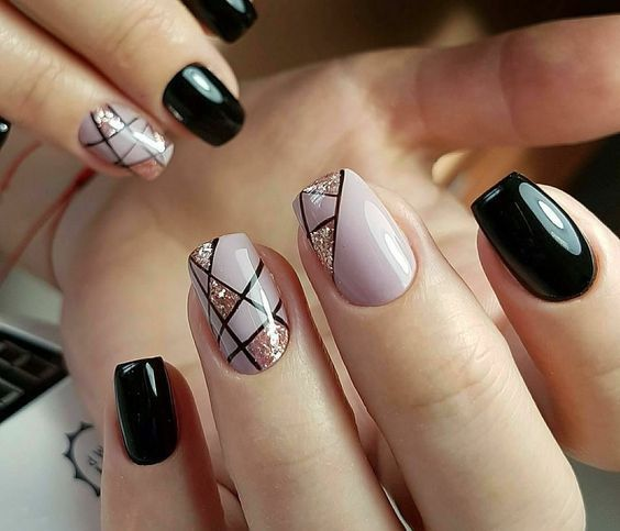 black and pink nails with stripes and glitter