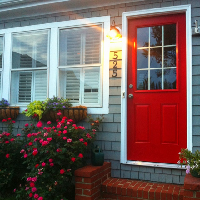 Red Door Gray Shingle Siding And Pretty Flower Boxes