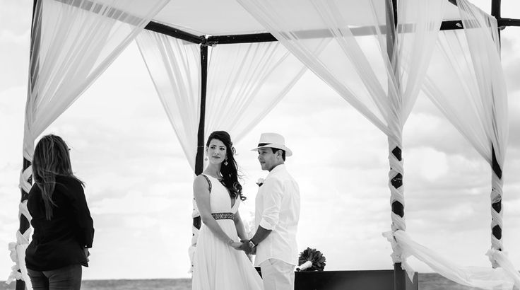 Beautiful black and white photo of bride and groom during a beach wedding ceremony at Sun Palace #cancunwedding