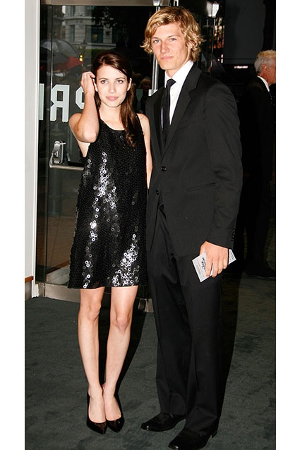 """Emma Roberts dated I Am Number Four star Alex Pettyfer in 2007, after the two co-starred in the film Wild Child. Though they broke up the next year, Pettyfer does have the remaining """"ER"""" tattoo of his famous ex-girlfriend's initials inside interlinking hearts on his right wrist."""