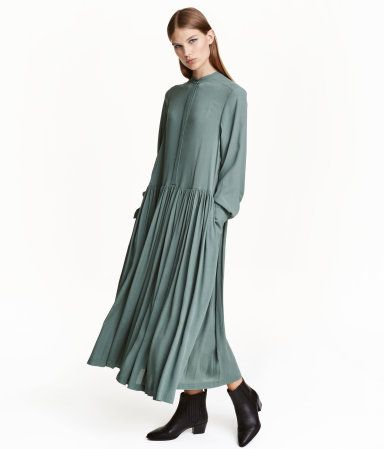 Green. Ankle-length dress in woven, crêped viscose fabric with a small stand-up collar, concealed buttons at front, long sleeves with wide cuffs with