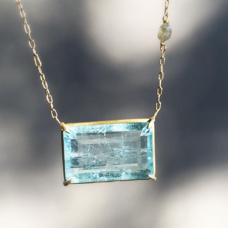 An icy blue aquamarine pendant by Rosanne Pugliese. #18k #aquamarine #rosannepugliese #finejewelery #jewellery #futureheirlooms #lovegold #augustla