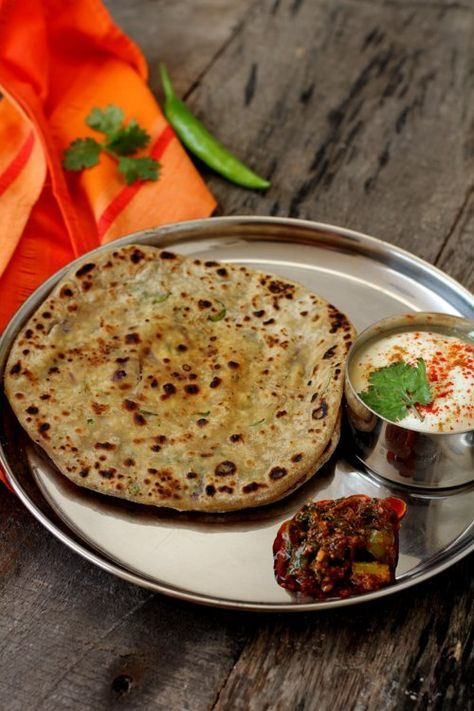 Paneer paratha recipe, a tasty Punjabi style, North Indian Indian flatbread.Learn quick & easy recipe of paneer paratha served with a side dish like raita