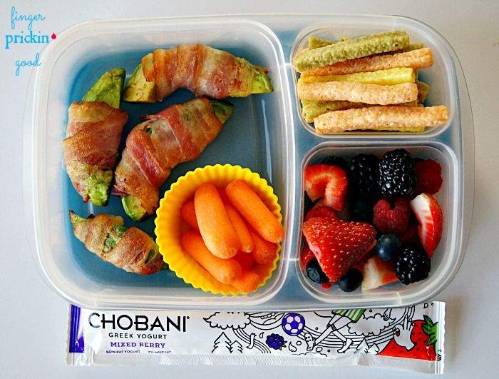 "Here's what's inside: Bacon & Avocado ""Fries"" (slice 1/2 avocado into thick slices, wrap avocado slices with bacon, and bake at 425 for 5-10 minutes or until bacon becomes crisp)= 8 carbs Fresh Fruit (strawberries, blueberries, blackberries, & raspberries)= 11 carbs Chobani Yogurt Tube= 7 carbs Veggie Straws= 8 carbs Carrots= 3 carbs Lunch Total= 37 carbohydrates"
