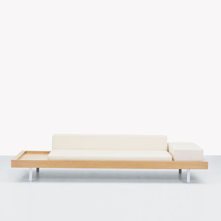 Multifunctional designer sofa with integrated coffee table