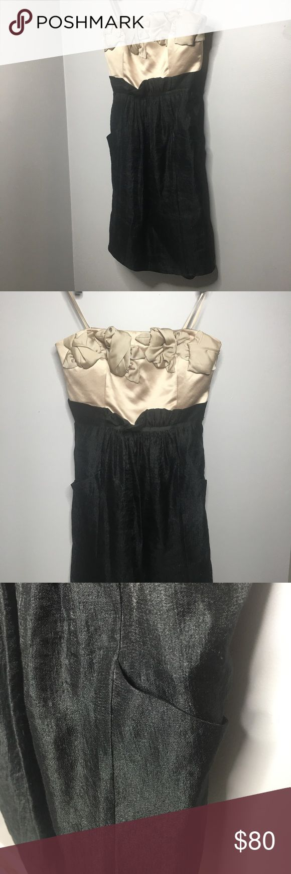 BCBG Black & Cream Cocktail dress. BCBG Black bodied, cream floral chest detail cocktail dress. Can be worn strapless or with optional silk strap. Ruffled detail at the rib cage. Pockets. Lays just above the knee. BCBG Dresses Wedding