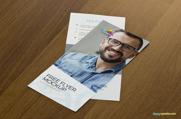Free flyer mockup with wooden background.