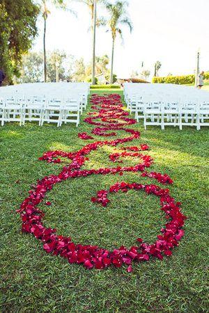 Rose petal design in aisle. I'm sure @Jennifer VonBehren would like this.