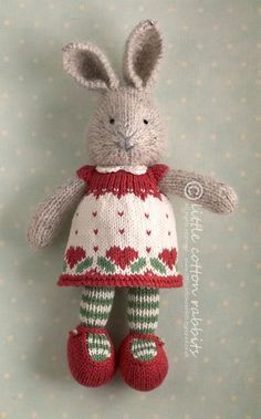 Bunny Girl (not this dress) knitting pattern £3.85 on Little Cotton Rabbits at http://littlecottonrabbits.typepad.co.uk/my_weblog/patterns-to-buy.html