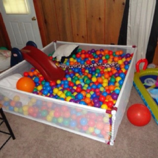 Homemade 5ft by 5ft ball pit. PVC from Home Depot, & netting from JoAnn's Fabrics. Best for home birthday parties during bad weather!
