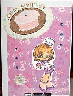 This is a birthday card featuring a Some Odd Girl stamp colored with Copic markers.
