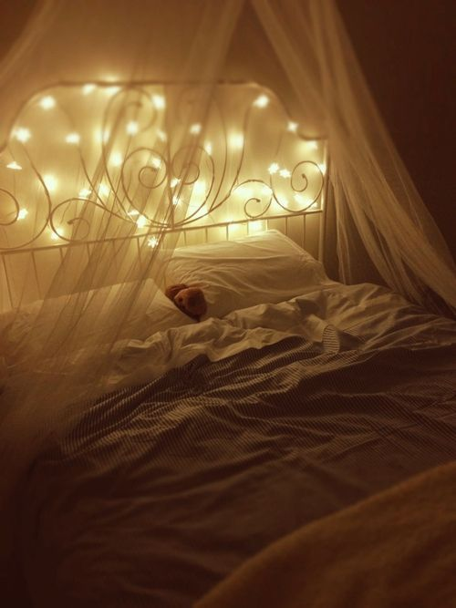Bedtime with fairylights; my daughters have this bed! I am so adding lights and a canopy!