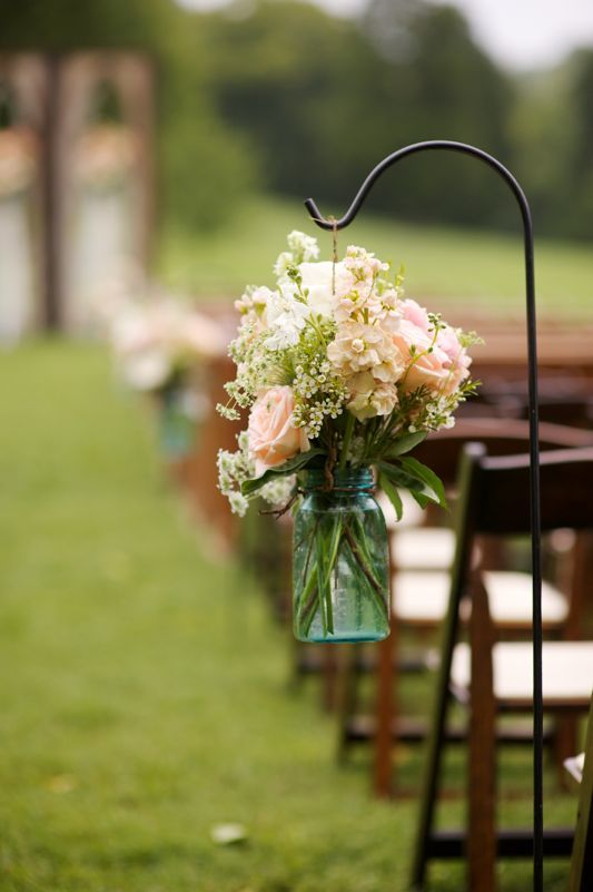 Cool hooks, could hang mason jars with flowers. You can get free-standing hooks (so can be used inside)