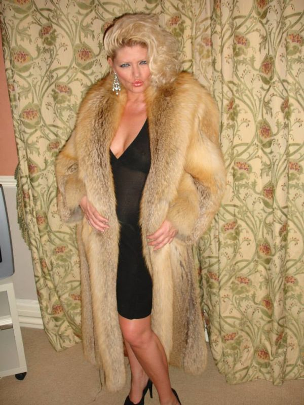 With porn star in a fur coat