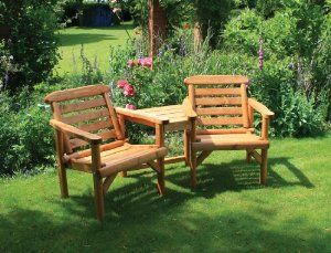 beautiful love seat for the garden and a table for tea and biscuits