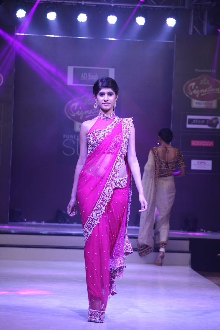 Hot Pink slim palo saree in fused velvet borders with swarovki elements and intricate embroidery. This one is teamed with a halter neck collared blouse.