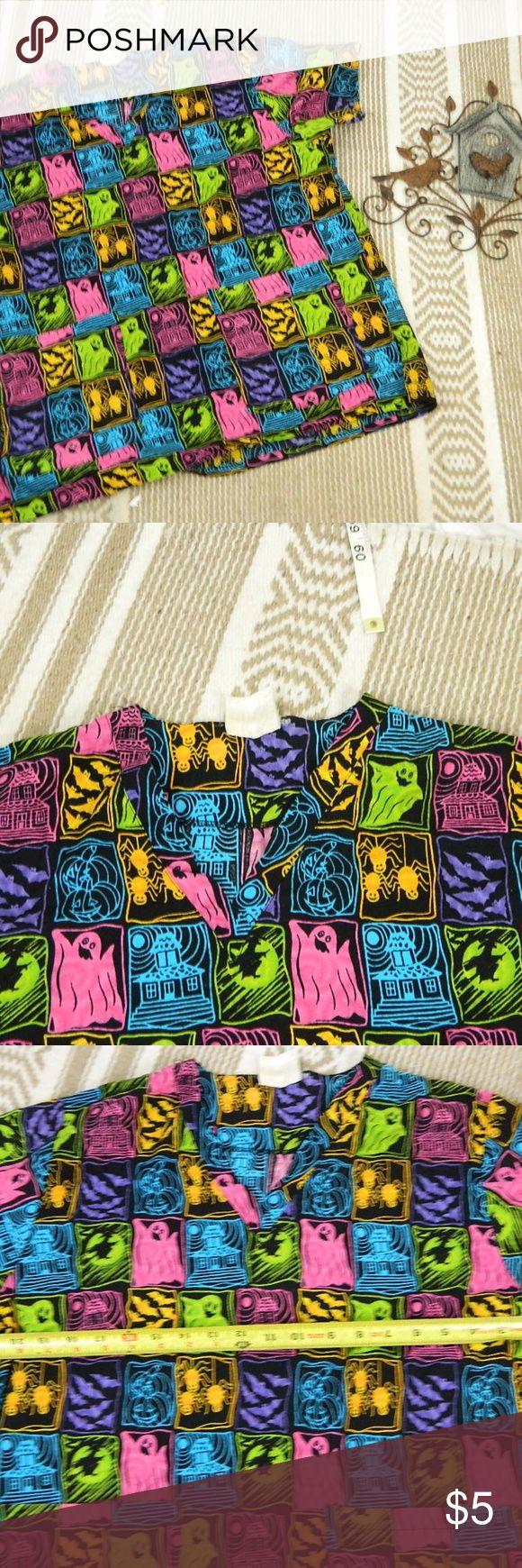 """Halloween Scrub Top Size ?Large?- not able to read Halloween Scrub Top Size ?Large?- not able to read size tag 2 pockets  armpit to armpit 22"""" length 25"""" unbranded Tops"""