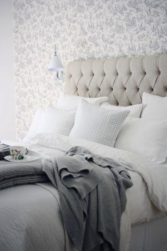 Linen tufted headboard and grey mixed bedding
