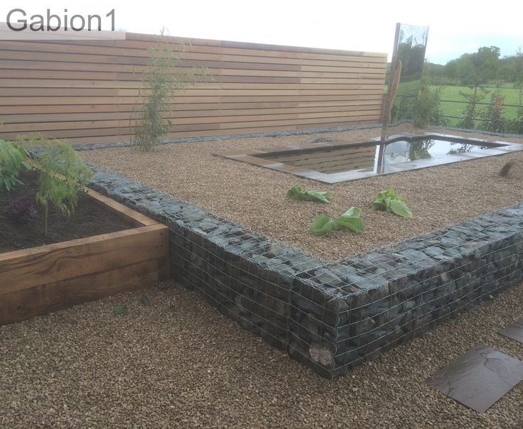 gabion retaining wall with raised water feature http