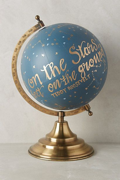 "Hand painted globe with Roosevelt's quote ""Keep your eyes on the stars and your feet on the ground""."