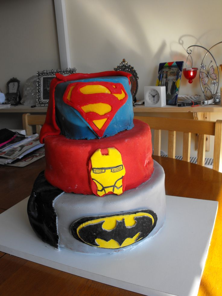 superhero cake - superman iron man and batman cake with two capes three tier cake one tier chocolate caramel biscuit cake two tires chocolate sponge with chocolate butter cream