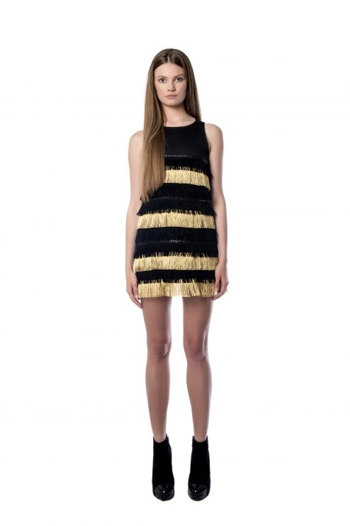 Sleeveless fringed dress  An impressive sleeveless fringed dress suitable for your next formal event. Created from black scuba, is decorated on the front with gold and black fringes. Its cut for a loose fit gives you a playful touch. Wear yours with single – sole sandals.