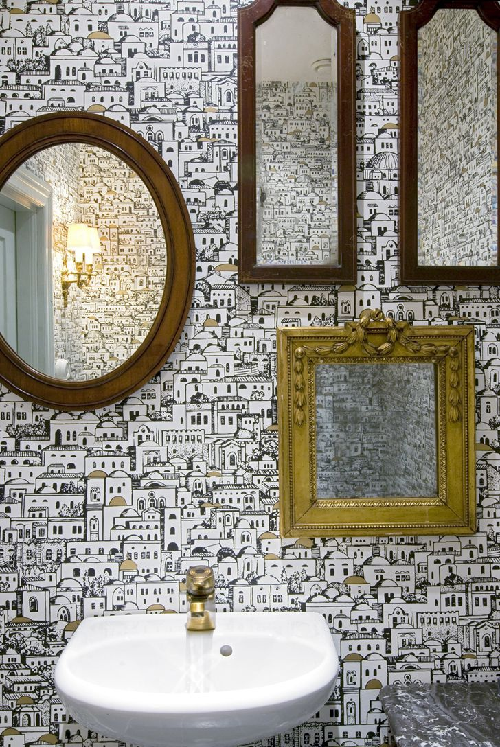 the toilet was made more interesting by adding several smaller mirrors for a quirky touch - Mirror Tile Castle Ideas