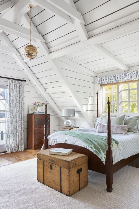 Oodles of shiplap. The laser-cut lantern casts soft shadows on the shiplap walls at night in this rustic bedroom.