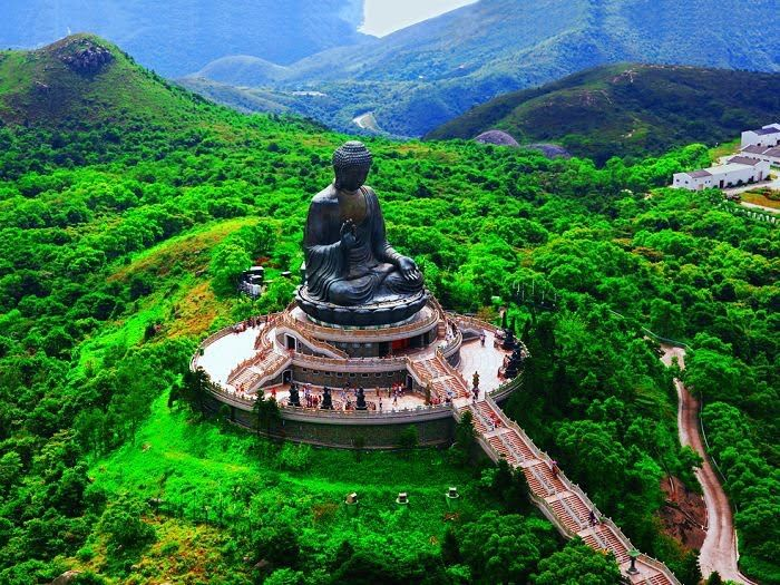 Tian Tan Buddha  - Hong Kong. A fabulous cable car ride plus over 200 steps to the top. A must do if you have at least a six hour layover at the airport.