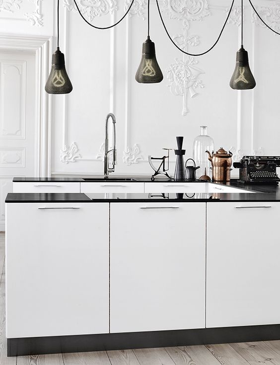 Original plumen 001 light bulbs with kayan combination gives of a elegant yet modern feel to this beautiful kitchen