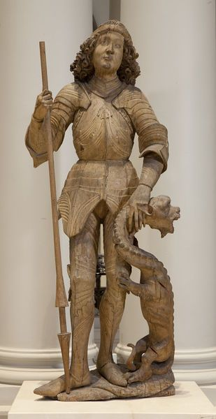 This is a figure of St. George in limewood, and carved from one piece of wood. It originally formed part of the central panel of an altarpiece. C. 1480-1490