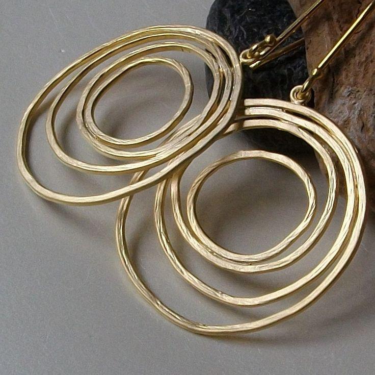 Gold Spiral Hoop Earrings. $18.00, via Etsy.