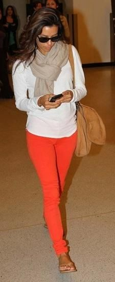 bright colored bottoms with a white loose top and neutral scarf