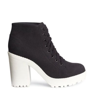 Platform shoes in canvas with laces at front and chunky rubber soles. Front platform height 1 1/4 in., heel height 4 1/4 in.