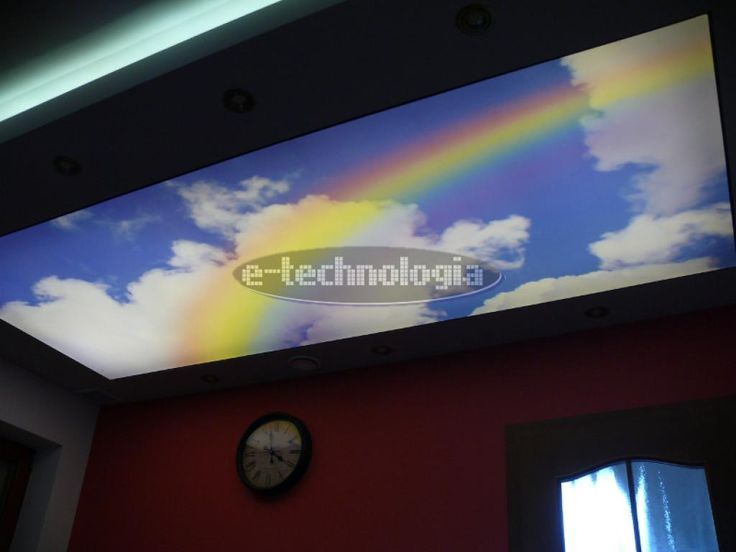 Stretch ceiling with print rainbow is a decorative motif, which brighten up your bedroom. The subdued colors will complement your interior design and LED strip installed beneath the shell ceiling brightens the room. The interior decor in the bedroom using LED lighting and ceiling of a tension will be much more impressive, and is a great inspiration to the bedroom. www.e-technologia.pl