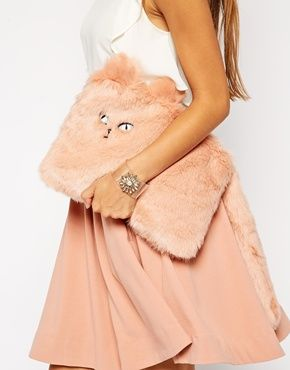 """The furry cat purse is a creepy looking clutch that is basically a square furry purse that has a face of a cat in the corner of it, and if it were to utter anything out of it's creepy little mouth, we are sure it would whisper the words ""Please Kill Me"""""