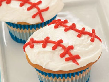 Hit it out of the park this baseball season with these white-frosted cupcakes, complete with red frosting seams.